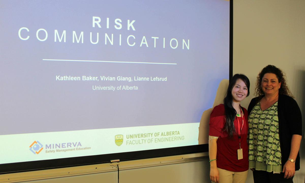 Risk communication presentation - Anneleen Muller (right) with University of Alberta student Vivian Giang